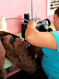 repairing a leather garment at LA Leather Cleaners